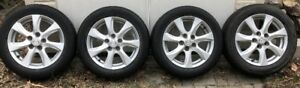 "Four (4) 16"" All-Season Tires on Aluminum Mazda Rims"
