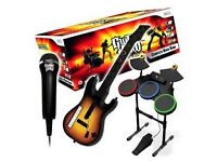 Wii with Guitar Hero Band and much more