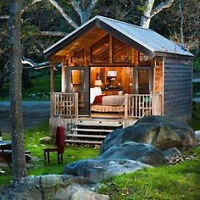 LOOKING WATERFRONT WITH SMALL BUNKIE OR COTTAGE