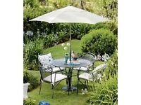 High quality patio furniture set, comprising of four chairs, table, parasol and covers.