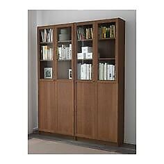 2 Ikea billy bookcase with oxberg glass panel doors in brown