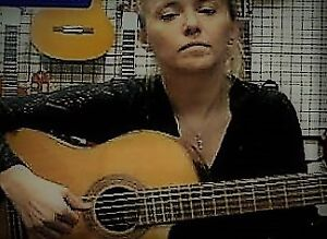 Classical guitar, with a cutaway, acoustic/electric.