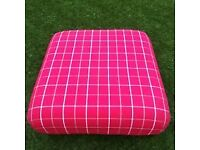 red and cream footstool
