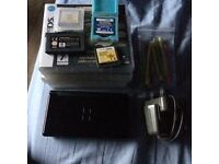 nintendo ds lite with 8 games and guitar hero grip