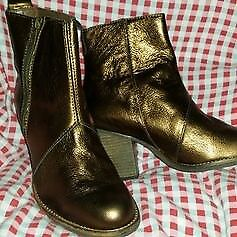 Brand new ladies bronze colour boots. Size 5. Boxed