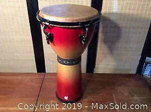 Some Sort Of Bongo Drum With Apple Logo