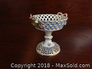 Rare DRESDEN bon bon dish. Hand painted with hand made painting of flowers. Height is 4 inches.