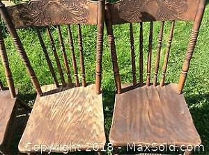 Four Wooden Press back Chairs