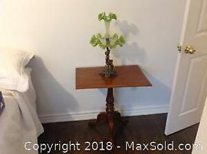 Green glass and bronze antique epergne or centerpiece. 20 Inches high.