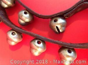 Antique Victorian sleigh bells with ORIGINAL leather strap. Length: 59 inches.