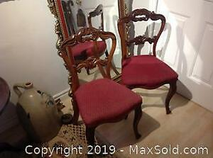 Two Rosewood matching early Victorian chairs.