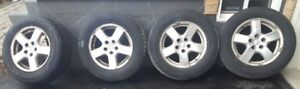 Dodge Grand Caravan 2005 OEM alloy wheels with tires 215/65R16.