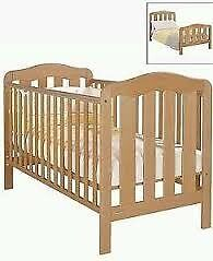 Mamas & Papas Cot, converts to small bed. With baby changing attachment which sits on top of cot.