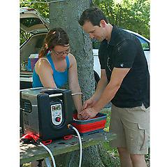 Brand new BaseCamp Aquacube portable hot water camping shower