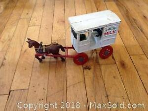 Cast iron toy milk wagon and driver. Hand painted..