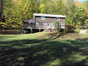 Family cottage on 13 wooded Acres, off the grid.