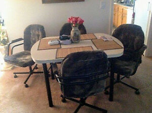 Table plus 4 chairs $150