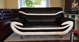 Black and white flux leather sofa can deliver