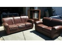 Used faux leather 3 seater & 2 seater sofas for sale with a medium sized fridge - 70 quid for lot