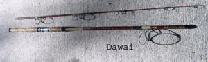 2  older fishing rods for ocean fishing.+ 2 Deep Six accessories