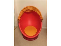 Ikea orange kids spinning tub egg chair with pull down hood