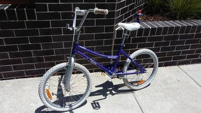 PURPLE BICYCLE WITH 20INCH WHEELS