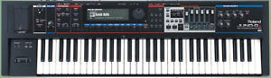 Roland Juno-Gi 61 Key Synthesizer w/bag, dust cover and stand