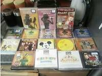 karaoke player and 29 disc dvds some sealed remote tv leads included
