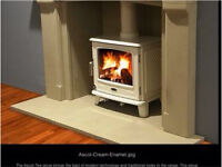 Gorgeous multi fuel burning 7 kW stove cast iron and cream enamelled finish.