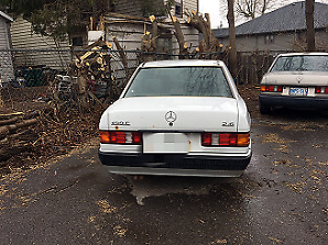 1990 Mercedes-Benz 190E white 4-door 200K km working well $1200
