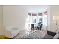 Newly refurbished three bedroom apartment set on the lower floor of this Victorian Mansion building