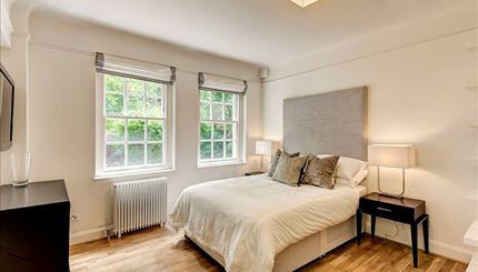 Bright lower ground floor studio apartment looking out on to the private communal gardens in Chelsea