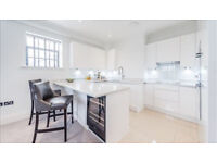A stunning brand new 2 bedroom, 2 bathroom apartment in gated dev on the River Thames in Hammersmith