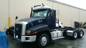 2014 (CAT) Day Cab Hwy Tractor.