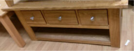 Solid Oak 3 Drawer coffee table with shelf.