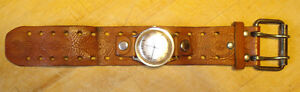 Vintage winding Timex watch with leather strap