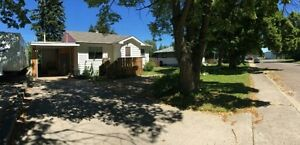 Afforadable home in an excellent location on huge lot!