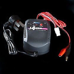 J4 charger . AC/DC battery charger. Unused