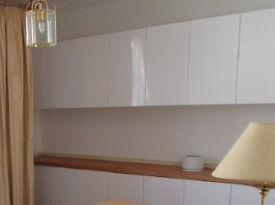 IKEA ABSTRAKT high-gloss white kitchen cabinets and doors