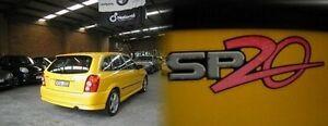 2002 Mazda 323 BJ II SP20 Yellow 5 Speed Manual Hatchback Heidelberg West Banyule Area Preview