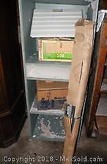 Vintage slide projector, movie reel, screen, slide viewer and slides