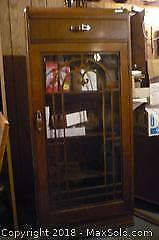 "Ornate Curio Cabinet with contents. 54"" tall 12"" wide 23"" length. -C"