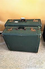 2 sets of leather bound luggage.