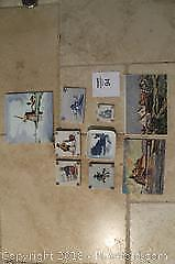 Varied antique tiles and wall plaques.