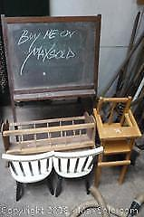 Lot of doll chairs doll crib and a chalk board. -A