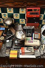 Movie Light Cameras Tape Recorder and More A