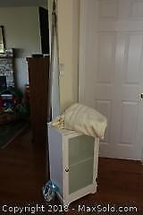 White Cabinet, Curtain Rods, and Curtains. B