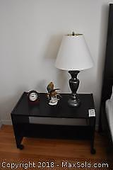 Lamp, Table, Figurine And Clock. A