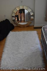 Mirror And Rug. A