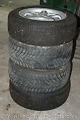 Four Goodyear Ultra Grip Winter Tires and Rims - C